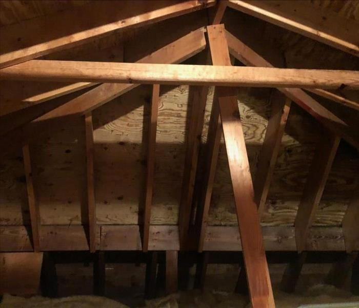 an attic interior with no insulation