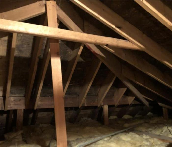 an attic with discolored insulation