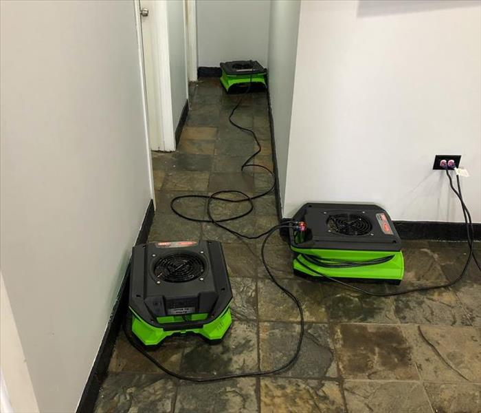 SERVPRO air movers set up to dry storm damage