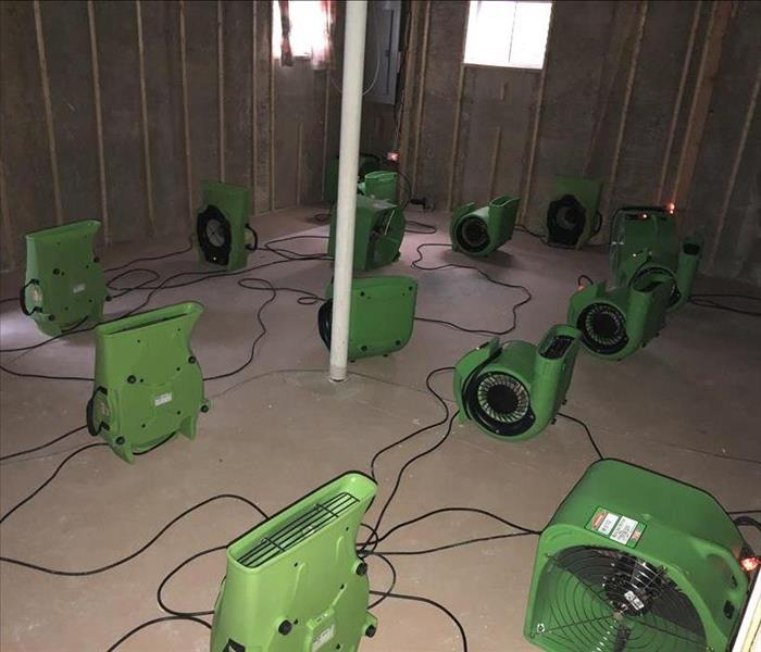 Air movers setup in the basement of a house