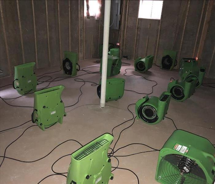 Drying equipment setup in a home hit by water damage