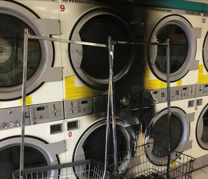 Dryer at laundromat caught fire