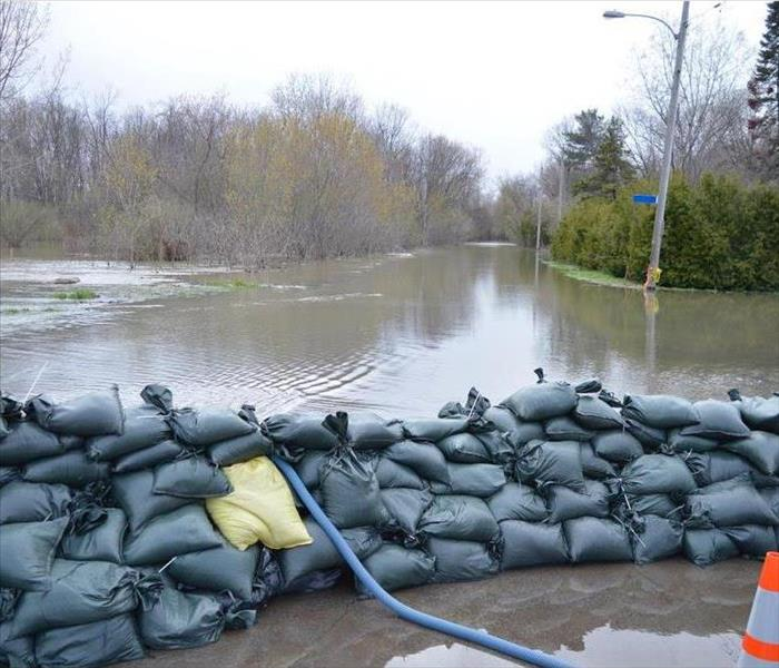 Flood waters outside with sandbags setup to prevent flood from spreading