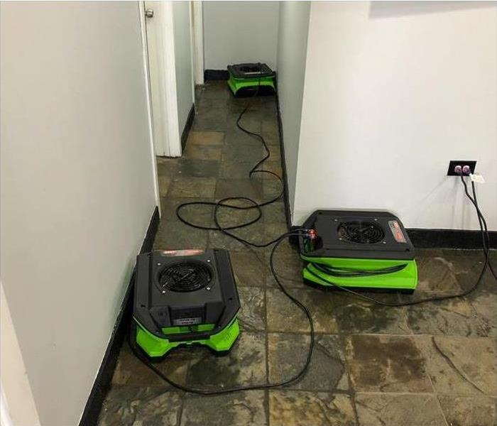 wet floor, three air movers placed on wet floor