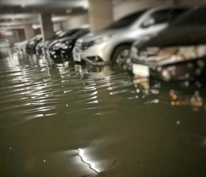 Parking garage flooded with black water