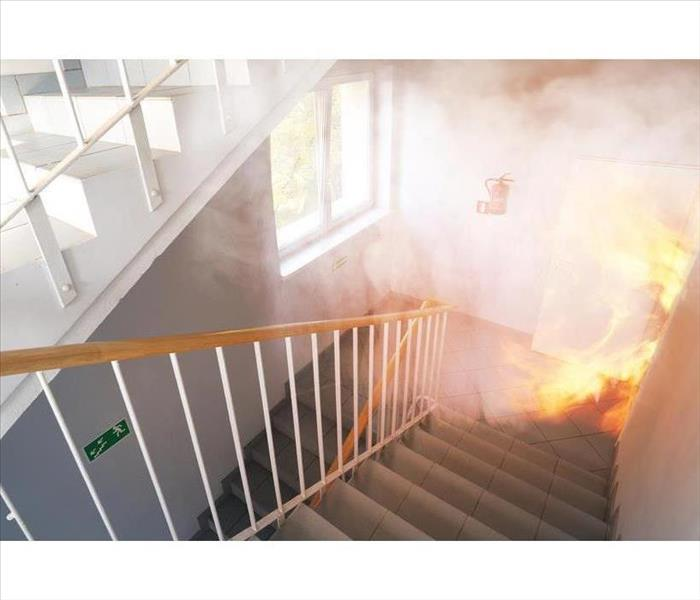 Fire spreads into stairwell of apartment building