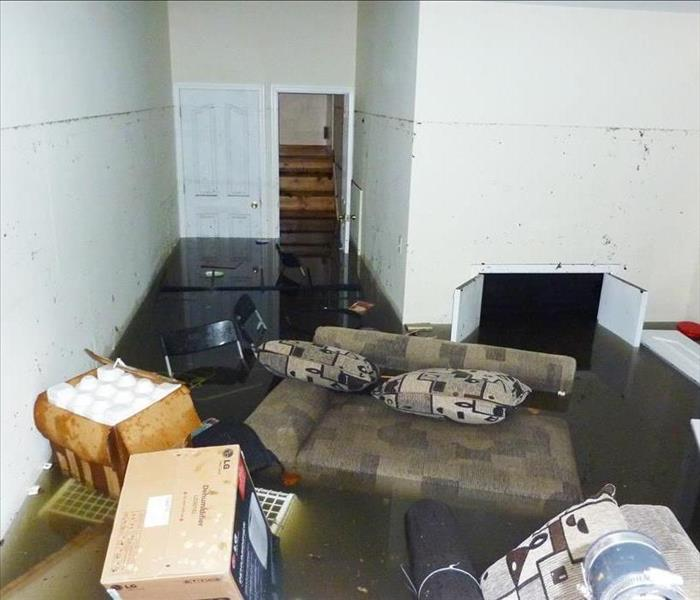 Completely flooded basement. It is visible line showing maximum water level higher than 7 feet.